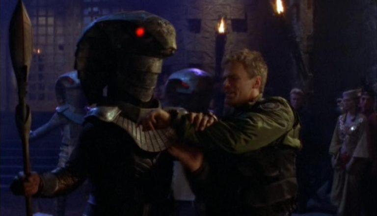 "Teal'c inspects O'Neill's wrist watch (""Children of the Gods"")"